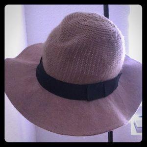 Brown floppy summer hat with black trim